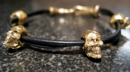 Four Skull Leather Bracelet